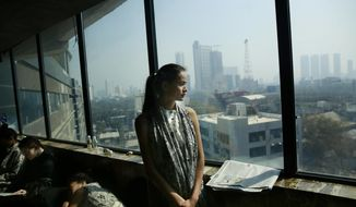 In this  Jan 30, 2017 photo, Anjali Lama, a transgender model from Nepal, looks out of a window of a hotel during a trial event for Lakme Fashion week in Mumbai, India. Growing up as the fifth son in a poor farming family in rural Nepal the dream to be a fashion model came late in life. First came a long, painful struggle to accept that he felt deeply female. It was a chance encounter with a group of transgender women that turned Lama's life around by putting her in touch with the Blue Diamond Society, an advocacy group for Nepal's LGBT community. In 2005 she came out to her friends and family as a transgender woman. (AP Photo/Rafiq Maqbool)
