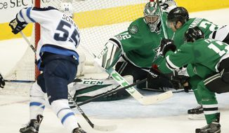 Winnipeg Jets center Mark Scheifele (55) attempts a shot against Dallas Stars goalie Kari Lehtonen (32) during the second period of an NHL hockey game, Thursday, Feb. 2, 2017, in Dallas. (AP Photo/Jim Cowsert)