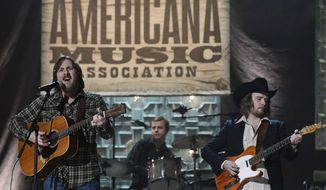 FILE - In this Sept. 17, 2014 file photo, Sturgill Simpson, left, performs during the Americana Music Honors and Awards show in Nashville, Tenn.  Top Grammy contenders Simpson and Chance the Rapper are set to perform at the awards show this month. The Recording Academy announced Thursday, Feb. 2, 2017 that fellow nominee William Bell and Grammy winners Little Big Town and Gary Clark Jr. will also perform on the live telecast on Feb. 12. (AP Photo/Mark Zaleski)