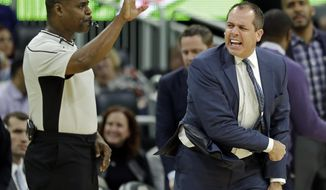 Orlando Magic coach Frank Vogel, right, draws a technical foul after he voiced his displeasure with a call by official Leroy Richardson, left, during the second half of the team's NBA basketball game against the Indiana Pacers, Wednesday, Feb. 1, 2017, in Orlando, Fla. Indiana won 98-88. (AP Photo/John Raoux)