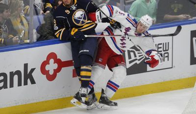 Buffalo Sabres forward Evander Kane (9) and New York Rangers defenseman Dan Girardi (5) battle for the puck during the second period of an NHL hockey game, Thursday Feb. 2, 2017, in Buffalo, N.Y. (AP Photo/Jeffrey T. Barnes)