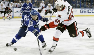 Tampa Bay Lightning center Vladislav Namestnikov (90), of Russia, deflects a slap shot by Ottawa Senators left wing Mike Hoffman (68) during the first period of an NHL hockey game Thursday, Feb. 2, 2017, in Tampa, Fla. (AP Photo/Chris O'Meara)