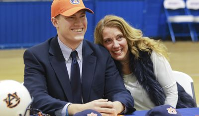 Bill Taylor smiles after signing to play for Auburn University on Wednesday, Feb. 1, 2017, at the American Christian Academy in Tuscaloosa, Ala. (Jake Arthur/The Tuscaloosa News via AP)
