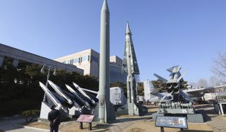 A mock North Korea's Scud-B missile, center left, and South Korean missiles are displayed at Korea War Memorial Museum in Seoul, South Korea, Thursday, Feb. 2, 2017. In his first public remarks abroad as U.S. defense secretary, Jim Mattis is criticizing North Korea for provocative acts that require new consultations with Japan and South Korea. (AP Photo/Ahn Young-joon)