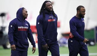 FILE - In this Dec. 14, 2016, file photo, New England Patriots NFL football running backs LeGarrette Blount, center, Dion Lewis, left, and James White, right, arrive for NFL football practice in Foxborough, Mass. For everything that Tom Brady has done to put the Patriots on the cusp of a fifth Super Bowl title, he has gotten plenty of help. Running back LeGarrette Blount and pass-catching threats Dion Lewis and James White give New England plentiful options. (AP Photo/Charles Krupa, File)