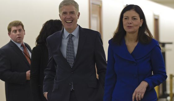 Supreme Court nominee Judge Neil Gorsuch, center, arrives with former New Hampshire Sen. Kelly Ayotte on Capitol Hill in Washington, Thursday, Feb. 2, 2017, for a meeting with Sen. Bob Corker, R-Tenn.  (AP Photo/Susan Walsh)