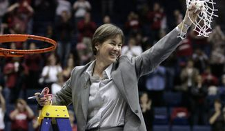 FILE - In this March 30, 2009, file photo, Stanford coach Tara VanDerveer cuts down the net after Stanford defeated Iowa State 74-53 to advance to the Final Four during a women's NCAA tournament regional championship college basketball game in Berkeley, Calif. On Friday night when No. 8 Stanford hosts USC, Vanderveer is poised to become just the second NCAA women's coach to enter the 1,000 wins club, alongside the late Pat Summitt. (AP Photo/Marcio Jose Sanchez, File)