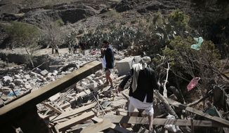Men walk amid the rubble of a house destroyed by a Saudi-led airstrike on the outskirts of Sanaa, Yemen, Thursday, Feb. 2, 2017. (AP Photo/Hani Mohammed) ** FILE **