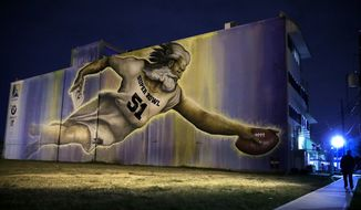 A mural for the NFL Super Bowl 51 football game is seen on the side of a building Friday, Feb. 3, 2017, in Houston. The New England Patriots will face the Atlanta Falcons in the Super Bowl Sunday. (AP Photo/Charlie Riedel)