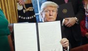President Donald Trump holds up an executive order after his signing the order in the Oval Office of the White House in Washington, Friday, Feb. 3, 2017. The executive order that will direct the Treasury secretary to review the 2010 Dodd-Frank financial oversight law, which reshaped financial regulation after 2008-2009 crisis. (AP Photo/Pablo Martinez Monsivais) ** FILE **