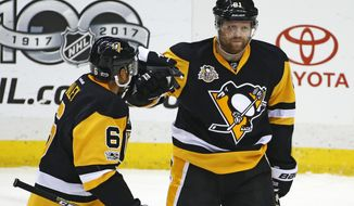 Pittsburgh Penguins' Phil Kessel (81) celebrates his goal with Trevor Daley (6) during the first period of an NHL hockey game against the Columbus Blue Jackets in Pittsburgh, Friday, Feb. 3, 2017. (AP Photo/Gene J. Puskar)