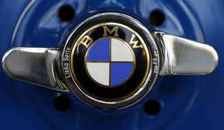 FILE - This March 7, 2016 file photo shows the logo of German car manufacturer BMW in Munich, Germany. BMW is recalling more than 230,000 cars and SUVs in the U.S. to replace potentially dangerous Takata air bag inflators announced Friday, Feb. 3, 2017. The recall covers certain 3 series cars from 2000 to 2002, some 5 series cars from 2001 to 2002, and some X5 SUVs from 2001 to 2003. (AP Photo/Matthias Schrader)