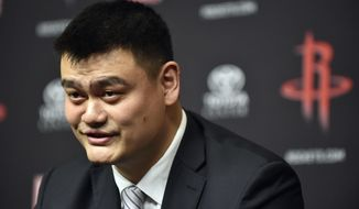 Retired Houston Rockets center Yao Ming speaks to the media before an NBA basketball game between the Houston Rockets and Chicago Bulls, Friday, Feb. 3, 2017, in Houston. Ming's jersey number will be retired during a halftime ceremony Friday night. (AP Photo/Eric Christian Smith)