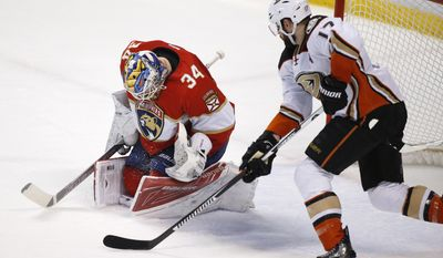 Anaheim Ducks center Ryan Kesler (17) attempts a shot at Florida Panthers goalie James Reimer (34) during the first period of an NHL hockey game, Friday, Feb. 3, 2017, in Sunrise, Fla. (AP Photo/Wilfredo Lee)