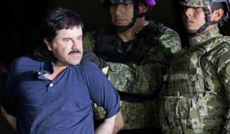 """FILE - In this Jan. 8, 2016 file photo, a handcuffed Joaquin """"El Chapo"""" Guzman is made to face the press as he is escorted to a helicopter by Mexican soldiers and marines at a federal hangar in Mexico City. Guzman is scheduled to appear in person in a federal court in New York. A judge initially ruled that Guzman would appear in court by video on Friday, Feb. 3, rather than have marshals escort him to and from a high-security Manhattan jail cell. The order was changed after his lawyers asked the judge to reconsider. (AP Photo/Eduardo Verdugo, File)"""