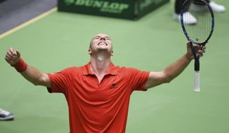 Belgium's Steve Darcis  celebrates after he won the first round single match of the Davis Cup against Germany's Philipp  Kohlschreiber., giving Belgium a 1-0 lead over Germany, in Frankfurt, Germany, Friday Feb. 3, 2017.   (Arne Dedert/dpa via AP)