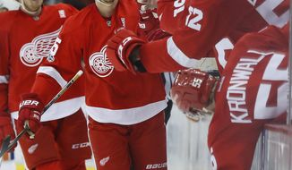 Detroit Red Wings defenseman Danny DeKeyser celebrates his goal against the New York Islanders during the third period of an NHL hockey game Friday, Feb. 3, 2017, in Detroit. (AP Photo/Paul Sancya)