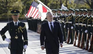 U.S. Defense Secretary Jim Mattis, right, is escorted to inspect an honor guard at Defense Ministry in Tokyo, Saturday, Feb. 4, 2017. Mattis on Friday reassured two key U.S. treaty allies, South Korea and Japan, that President Donald Trump, who has raised doubts about the value of such partnerships, is fully committed to defending them. (AP Photo/Eugene Hoshiko)