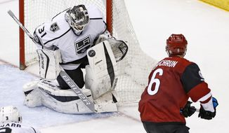 Los Angeles Kings goalie Peter Budaj (31) makes a save on a shot by Arizona Coyotes defenseman Jakob Chychrun (6) during the third period of an NHL hockey game Tuesday, Jan. 31, 2017, in Glendale, Ariz. The Kings defeated the Coyotes 3-2. (AP Photo/Ross D. Franklin)
