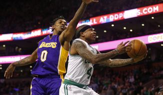 Boston Celtics' Isaiah Thomas goes to the basket past Los Angeles Lakers' Nick Young during the second quarter of an NBA basketball game in Boston Friday, Feb. 3, 2017. (AP Photo/Winslow Townson)