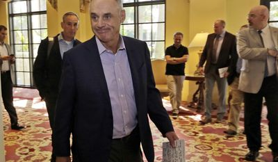Major League Baseball Commissioner Rob Manfred walks to a news conference following a meeting with MLB owners, Friday, Feb. 3, 2017, in Palm Beach, Fla. (AP Photo/Lynne Sladky)