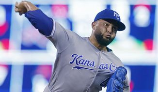 FILE - In this Sept. 6, 2016 file photo, Kansas City Royals pitcher Kelvin Herrera throws against the Minnesota Twins during the eighth inning of a baseball game  in Minneapolis.  The Royals and  Herrera have agreed to a $5,325,000, one-year contract, Friday, Feb. 3, 2017,  avoiding arbitration with one of the top relievers in baseball. (AP Photo/Jim Mone)