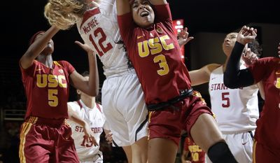 Southern California guard Minyon Moore (3) vies for a rebound against Stanford guard Brittany McPhee (12) during the first half of an NCAA college basketball game Friday, Feb. 3, 2017, in Stanford, Calif. (AP Photo/Marcio Jose Sanchez)