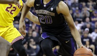Washington's Markelle Fultz, right, tries to drive past Southern California's De'Anthony Melton (22) during the second half of an NCAA college basketball game Wednesday, Feb. 1, 2017, in Seattle. USC won 82-74. (AP Photo/Elaine Thompson)
