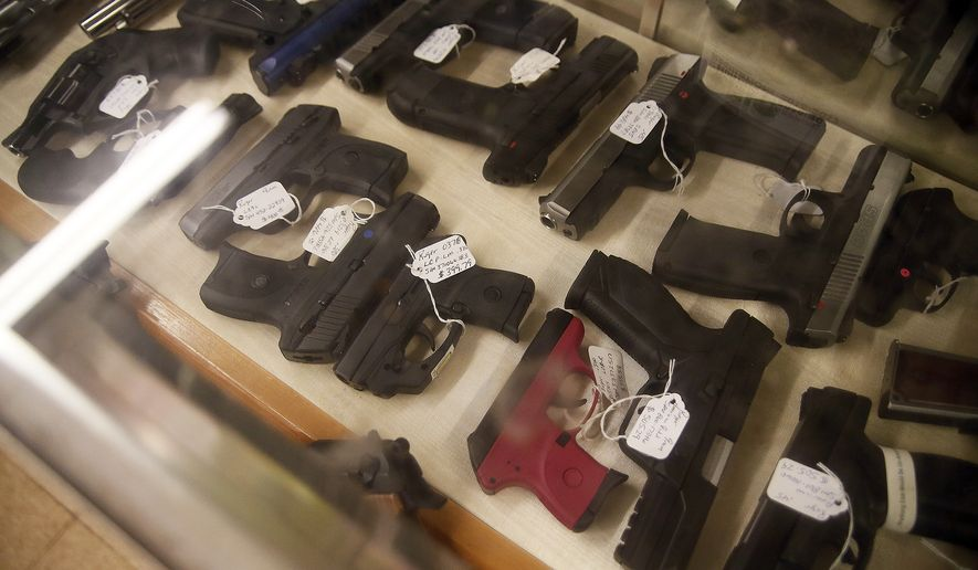 Gun purchase background checks snapped a five-month streak of year-over-year declines in May. (Associated Press/File)