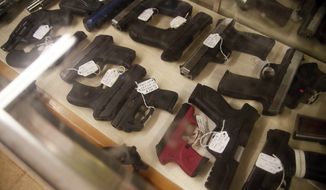 Guns are displayed for sale at the Ohio Supply & Tool in Wadsworth, Ohio, on Thursday, Jan. 26, 2017. The year 2016 is easily on pace to shatter the record of 96,972 permits issued in 2013, an inflection point in America when the number of guns (357 million) surpassed people (316 million). (Leah Klafczynski/Akron Beacon Journal via AP)