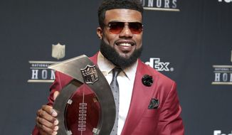 Ezekiel Elliott of the Dallas Cowboys poses in the press room with the FedEx Air & Ground Award at the 6th annual NFL Honors at the Wortham Center on Saturday, Feb. 4, 2017, in Houston. (Photo by Jeff Lewis/Invision for NFL via AP)