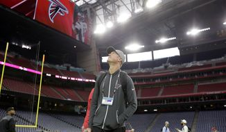 Atlanta Falcons quarterback Matt Ryan looks around the field during a walk through at NRG Stadium on the eve of NFL Super Bowl 51 football game Saturday, Feb. 4, 2017, in Houston. Atlanta will face the New England Patriots in the Super Bowl Sunday. (AP Photo/Eric Gay)
