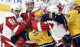 Nashville Predators left wing Cody McLeod (55) scuffles with Detroit Red Wings players during the first period of an NHL hockey game Saturday, Feb. 4, 2017, in Nashville, Tenn. (AP Photo/Mark Zaleski)