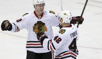 Chicago Blackhawks defenseman Gustav Forsling (42) celebrates his goal with center Dennis Rasmussen (70) during the second period of the team's NHL hockey game against the Dallas Stars in Dallas, Saturday, Feb. 4, 2017. (AP Photo/LM Otero)