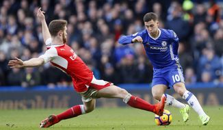 Chelsea's Eden Hazard, right avoids a tackle by Arsenal's Shkodran Mustafi during the English Premier League soccer match between Chelsea and Arsenal at Stamford Bridge stadium in London, Saturday, Feb. 4, 2017. (AP Photo/Kirsty Wigglesworth)