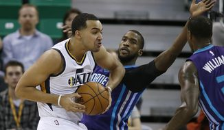 CORRECTS DAY OF THE WEEK TO SATURDAY INSTEAD OF MONDAY - Utah Jazz forward Trey Lyles (41) is guarded by Charlotte Hornets forward Michael Kidd-Gilchrist (14) during an NBA basketball game, Saturday, Feb. 4, 2017, in Salt Lake City. (AP Photo/George Frey)