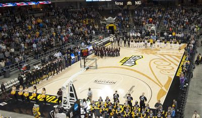 In this Friday, Jan. 20, 2017, photo provided by Northern Kentucky University, North Kentucky gets set to taken on Oakland (Mich.) in an NCAA college basketball game at BB&T Arena in Highland Heights, Ky. College basketball floors once had simple designs, the only flair usually the addition of color in the lane or at midcourt. Court designs have taken a creative twist over the past few years with schools adding elaborate detail. (Tim Sofranko/Northern Kentucky University via AP)