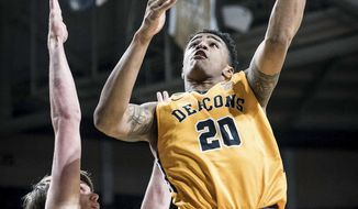 Wake Forest forward John Collins (20) shoots over Georgia Tech center Ben Lammers in an NCAA basketball game Saturday, Feb. 4, 2017 at Joel Coliseum in Winston-Salem, N.C. The Demon Deacons defeated the Yellow Jackets, 81-69. (Allison Lee Isley/The Winston-Salem Journal via AP)