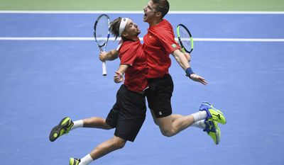 Belgium's  Joris De Loore, right, and Ruben Bemelmans celebrate  in their doubles match against Germany's Alexander and Mischa Zverev, during the Davis Cup first round match between Germany and Belgium in Frankfurt, Germany, Saturday Feb. 4, 2017.  Belgium won the doubles match  and leads by 2-1.  (Arne Dedert/dpa via AP)