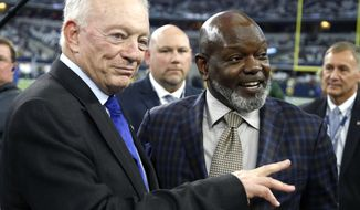 FILE - In this Jan. 15, 2017, file photo, Dallas Cowboys owner Jerry Jones, left, and former running back Emmitt Smith talk before an NFL divisional playoff football game against the Green Bay Packers in Arlington, Texas. Jones is part of seven-man class heading into the Pro Football Hall of Fame, it was announced Saturday, Feb. 4, 2017. (AP Photo/Michael Ainsworth, File)