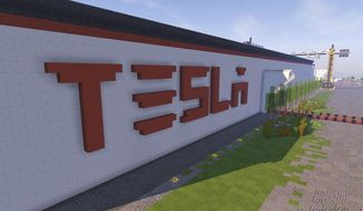 """In this undated photo received on Saturday, Feb. 4, 2017 taken by Darius Kniuksta, a scene from a video game featuring a Tesla gigafactory.  Lithuanians badly want Tesla Motors to build its next giant factory on their soil, so to grab the attention of the California tech company they built a virtual version of a facility inside the """"Minecraft"""" video game. Vladas Lasas, who was behind the project, says they wanted to send a message to Tesla CEO Elon Musk that Lithuania """"has plenty of skillful"""" people as well as a perfect factory site. (Darius Kniuksta via AP)"""