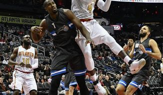 Atlanta Hawks forward Paul Millsap (4) shoots as Orlando Magic forward Serge Ibaka (7), of the Republic of Congo, defends during the first half of an NBA basketball game, Saturday, Feb. 4, 2017, in Atlanta. (AP Photo/John Amis)