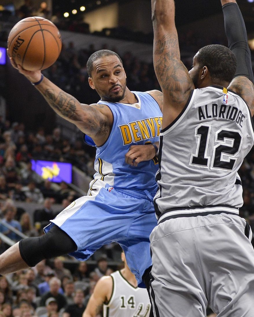 Denver Nuggets Guard Jameer Nelson, Left, Looks To Pass