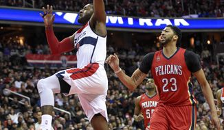 Washington Wizards guard John Wall (2) goes to the basket past New Orleans Pelicans forward Anthony Davis (23) during the second half of an NBA basketball game, Saturday, Feb. 4, 2017, in Washington. The Wizards won 105-91. (AP Photo/Nick Wass)