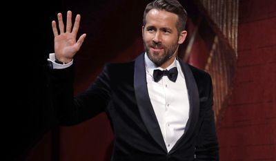 """Actor Ryan Reynolds waves as he is introduced during a roast at Harvard University in Cambridge, Mass., Friday, Feb. 3, 2017. Reynolds was honored as """"Man of the Year"""" by the Hasty Pudding Theatricals at Harvard University. (AP Photo/Charles Krupa)"""