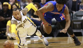Indiana Pacers guard Monta Ellis, left, and Detroit Pistons forward Stanley Johnson chase a loose ball in the second half of an NBA basketball game, Saturday, Feb. 4, 2017, in Indianapolis. Indiana won 105-84. (AP Photo/R Brent Smith)