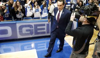 Duke head coach Mike Krzyzewski comes on to the court prior to the start of an NCAA college basketball game against Pittsburgh in Durham, N.C., Saturday, Feb. 4, 2017. (AP Photo/Karl B DeBlaker)