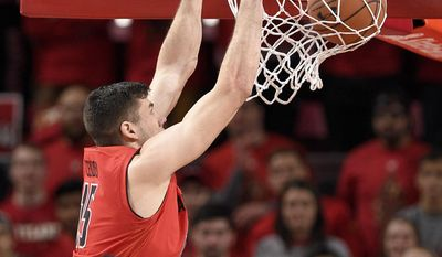 Maryland forward Michal Cekovsky (15) dunks against Purdue forward Caleb Swanigan (50) during the first half of an NCAA college basketball game, Saturday, Feb. 4, 2017, in College Park, Md. (AP Photo/Nick Wass)