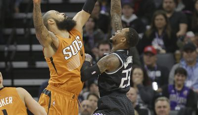 Sacramento Kings guard Ben McLemore, right, shoots over Phoenix Suns center Tyson Chandler during the first quarter of an NBA basketball game Friday, Feb. 3, 2017, in Sacramento, Calif. (AP Photo/Rich Pedroncelli)