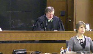 This still image taken from United States Courts shows Judge James Robart listening to a case at Seattle Courthouse on March 12, 2013 in Seattle.  Robart placed a nationwide hold on President Donald Trump's executive order, banning  travel to the United States by migrants from seven Muslim-majority countries, Friday, Feb. 3, 2017. (United States Courts via AP) ** FILE **